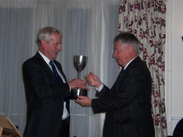 chairman presents Winners Trophy to Paul Turner