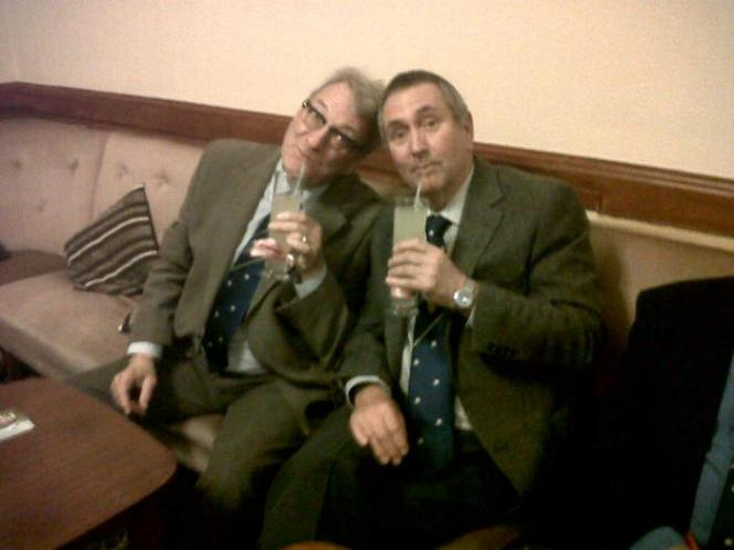John and Alan with pink ribboned glasses of Ginger Beer